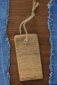 Blue jean on wood background — Photo
