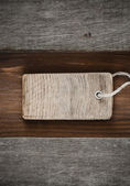 Price tag over wood — Stock Photo