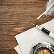 Stock Photo: Compass and ink pen at envelope