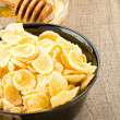 Bowl of corn flakes and nutrition — Stock Photo