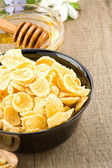 Bowl of corn flakes and nutrition — Stockfoto