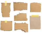 Cardboard pieces on white — Stock Photo