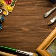 Brush and painting on wood — Stock Photo