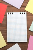 Note paper and checked notepad — Stock Photo