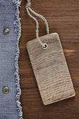 Blue jean on wood texture — Stock Photo