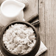 Bowl of oatmeal on wood — Stock Photo