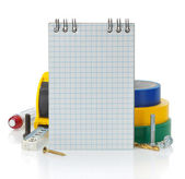 Notebook and tools on white — Stock Photo
