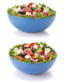 Salad in bowl on white — Stock Photo