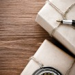 Parcel wrapped with brown paper on wood — Stock Photo #32481441