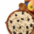Stock Photo: Plate of oatmeal isolated