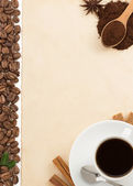 Cup of coffee and parchment — Stock Photo