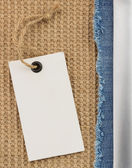 Jeans and burlap hessian — Stock Photo