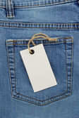 Jeans texture and price tag — Stock Photo