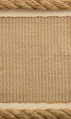 Cuerdas y papel viejo en arpillera saco — Foto de Stock