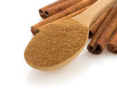 Cinnamon in spoon on white — Stock Photo