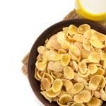 Bowl of corn flakes on white — Stock Photo #36497357
