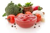 Tomato sauce in bowl on white — Stock Photo