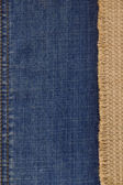 Jeans and burlap hessian background — Stock Photo