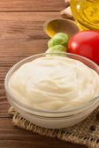 Mayonnaise sauce in bowl on wood — Stock Photo