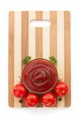 Tomato sauce on cutting board — Stock Photo