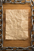 Metal chain and old paper — Stock Photo