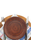 Plate, knife and fork  at cutting board  — Stock Photo