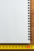 Checked notebook on wood — Stock Photo