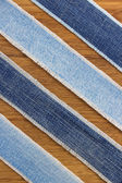 Jeans strips at wood — Stock fotografie