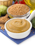 Mustard sauce in bowl on white — Stock Photo