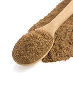 Allspice powder and wooden spoon — Stock Photo