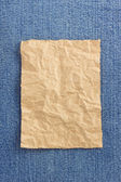 Wrinkled parcel paper at jeans  — Stock Photo
