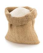 Sugar granules in bag on white — Stock Photo