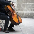 Busker playing cello — Stock Photo