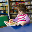 Child reads a book — Stock Photo