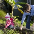 Mother and child works in the garden — Stock Photo