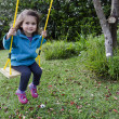 Little girl on a swing — Stock Photo