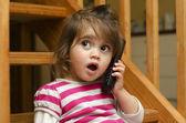 Little girl speak on the phone — Stock Photo
