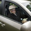 Old man driving a car — Stock Photo