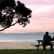 Photo: Young couple enjoys the sunset