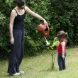 Mother and daughter gardening — Stock Photo #13051564