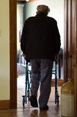 Elderly man use a walker (walking frame) — Stock Photo