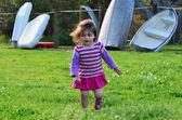 Little girl in a green field — Stock Photo