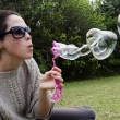 Young woman play with bubble wand — Stock Photo #13828143
