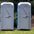 Two portable bathrooms — Stockfoto