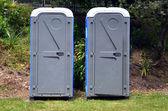 Two portable bathrooms — Stock Photo