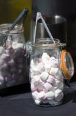 Marshmallow in a glass jar — Stock Photo