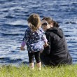 Mothers and daughters on a lake — Stockfoto