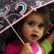 Little girl holds umbrella — 图库照片