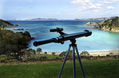Telescope pointing at the sea — Stock Photo