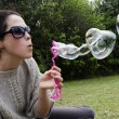 Young woman play with bubble wand — Stock Photo #16340633